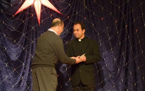 Trustee Mr. George Joseph presenting mission's gift to Fr. Joseph Pullikattil